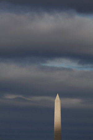 Sun breaks through on the Washington Monument.