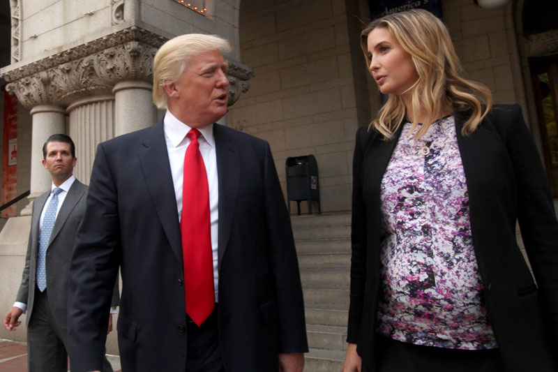 Real estate developer Donald Trump, center, his daughter Ivanka Trump, executive vice president of development and acquisitions at Trump Organization LLC, and his son Donald Trump Jr., left, walk outside the Old Post Office Pavilion following a news conference in Washington, D.C. Photographer: Julia Schmalz/Bloomberg